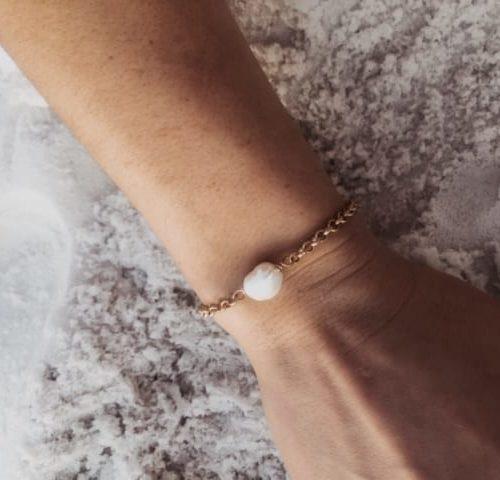 kirstin bracelet on model on beach